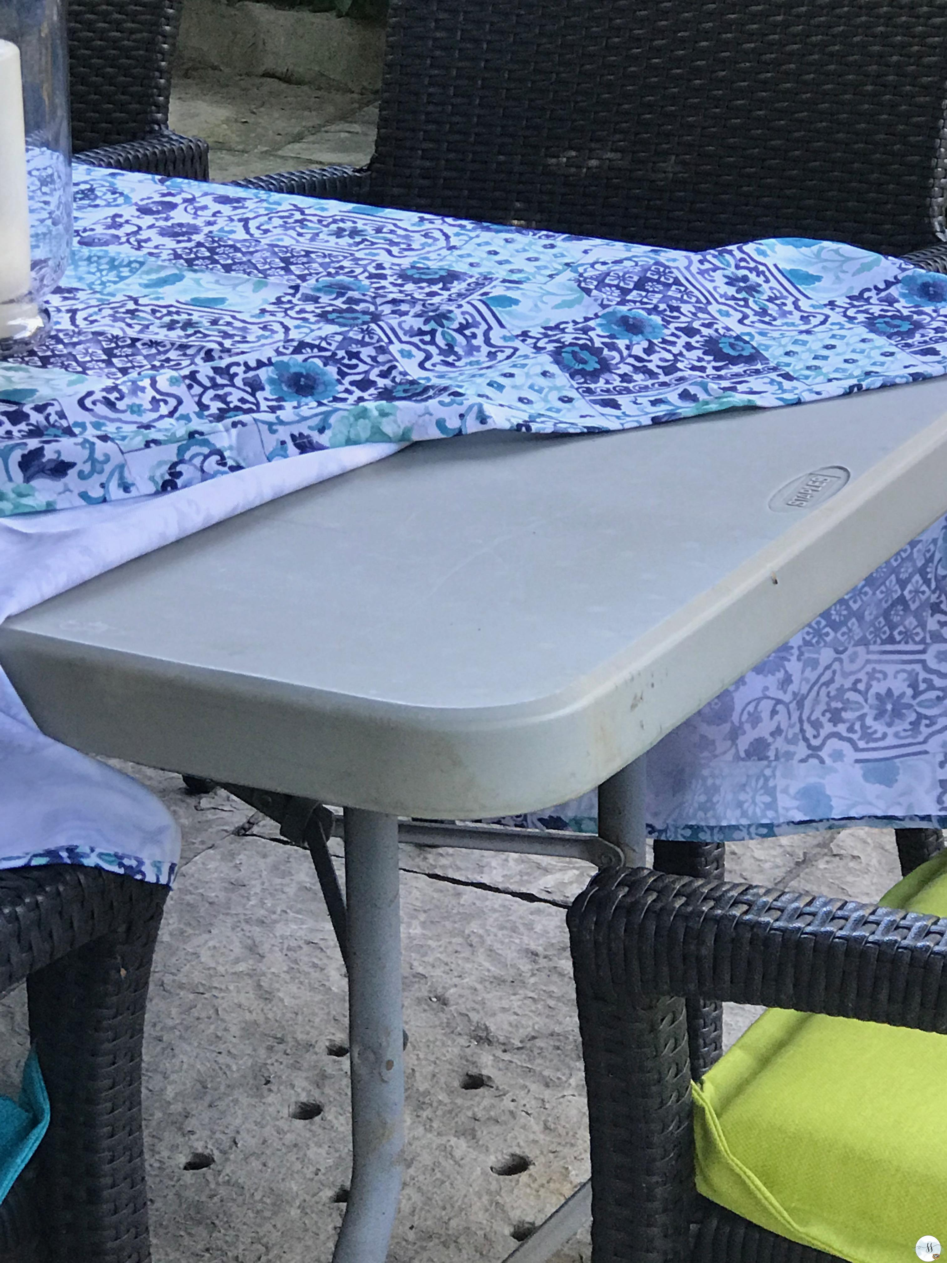 Folding table as an outdoor dining table works in a pinch.