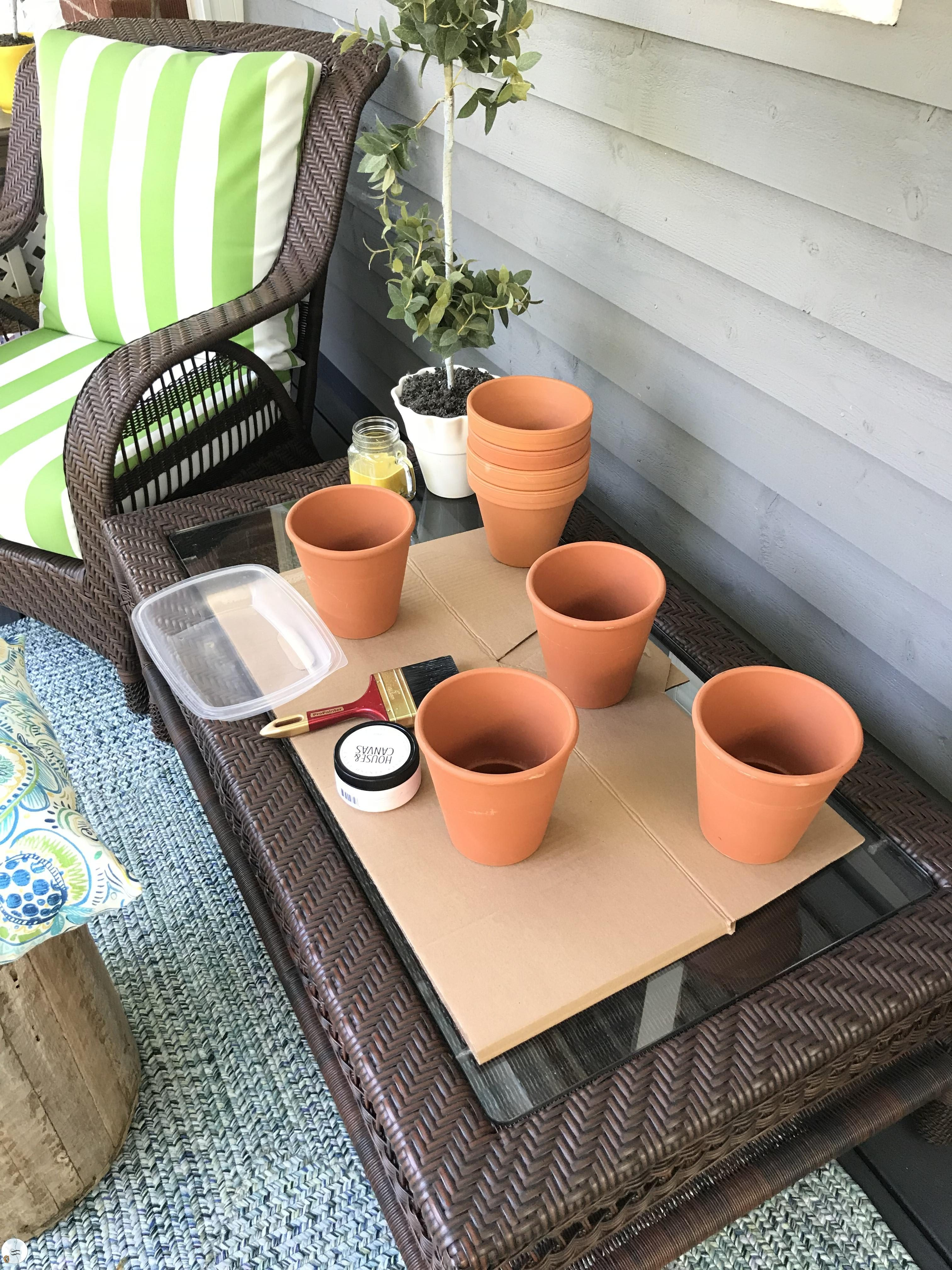Super easy DIY project. Aged flower pots with house numbers. Great summer time project