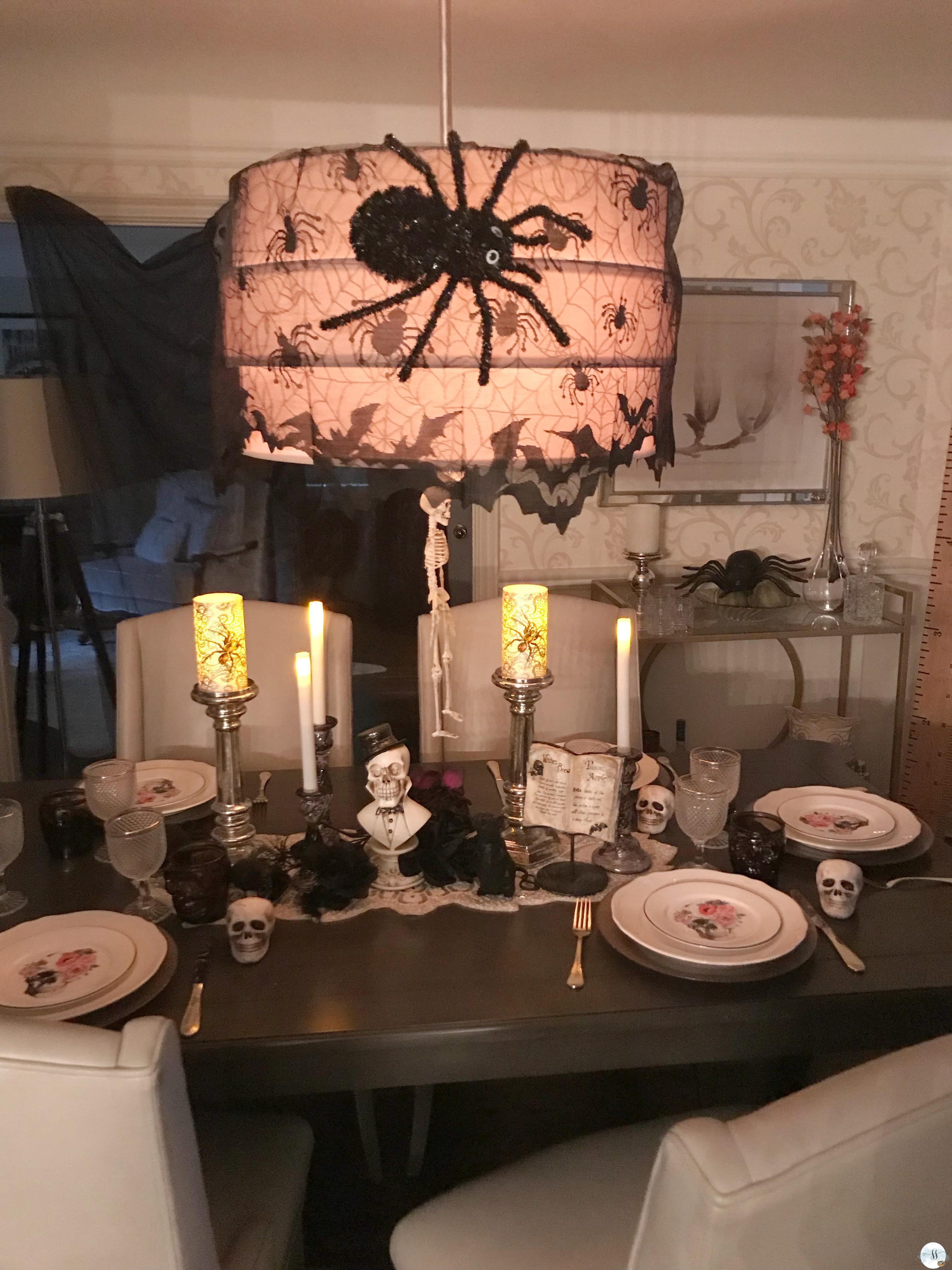 Halloween table scape, with skulls and spooky spiders