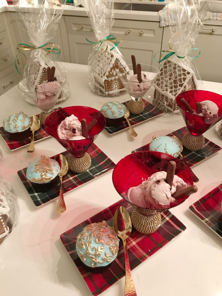 Christmas desserts cupcakes and gingerbread houses.
