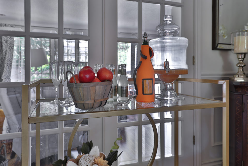 fall themed bar cart using champagne, apples and popcorn
