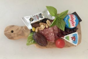 Charcuterie board for one staying safe while social distancing. Great idea for entertaining use single serve charcuterie boards.